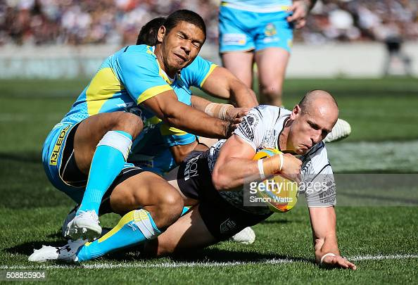Warriors player Jeff Robson scores a try during the 2016 Auckland Nines semifinal match between the Titams and the Warriors at Eden Park on February...