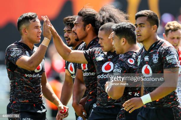 Warriors players celebrate a try during the 2017 Auckland Nines match between the New Zealand Warriors and the St George Illawarra Dragons at Eden...