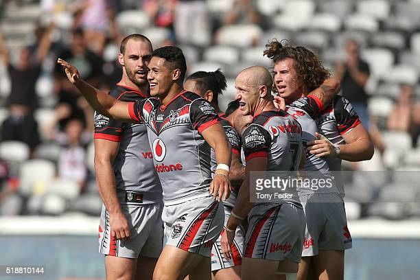 Warriors players celebrate a try during the round five NRL match between the Sydney Roosters and the New Zealand Warriors at Central Coast Stadium on...