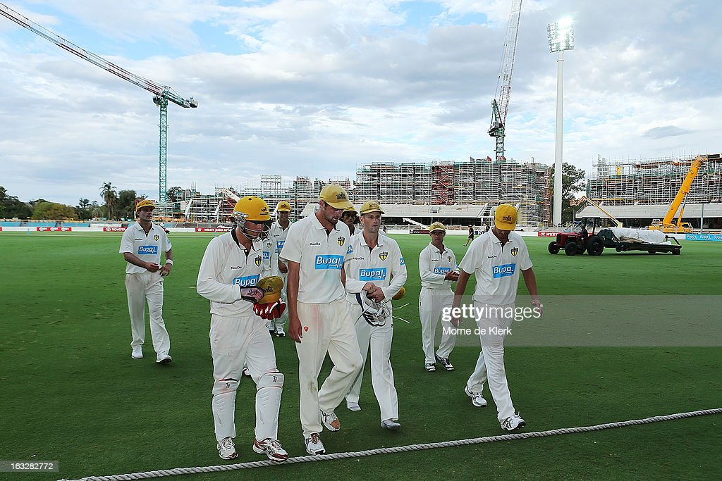 Warriors players leave the field after play on day one of the Sheffield Shield match between the South Australian redbacks and the Western Australia Warriors at Adelaide Oval on March 7, 2013 in Adelaide, Australia.