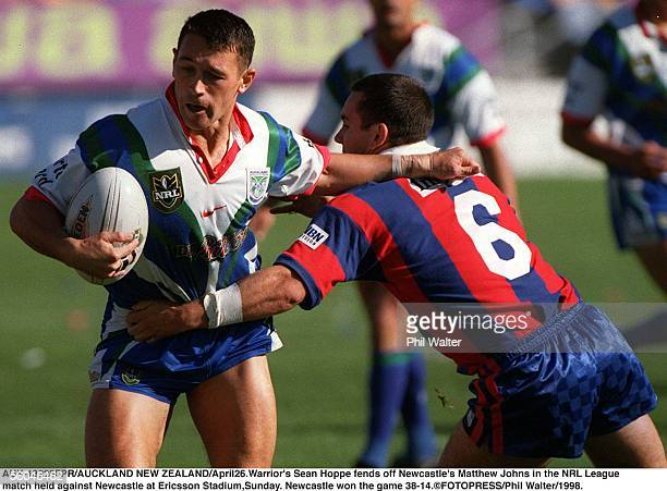 Warrior's Sean Hoppe fends off Newcastle's Matthew Johns in the NRL League rmatch held against Newcastle at Ericsson StadiumSunday Newcastle won the...