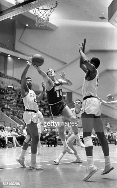 Warriors' Tom Meschery drives past two Piston players Ray Scott and Joe Strawder to score during the 1st period of the DetroitSan Fransisco game 3/2...