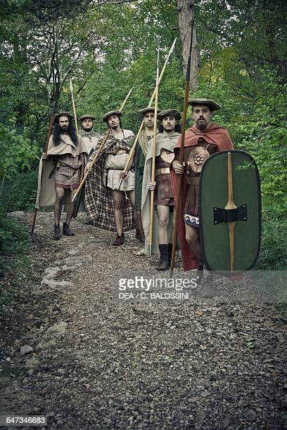 Warriors with spears and shields on patrol in a forest Illyrian civilisation mid3rd century BC Historical reenactment