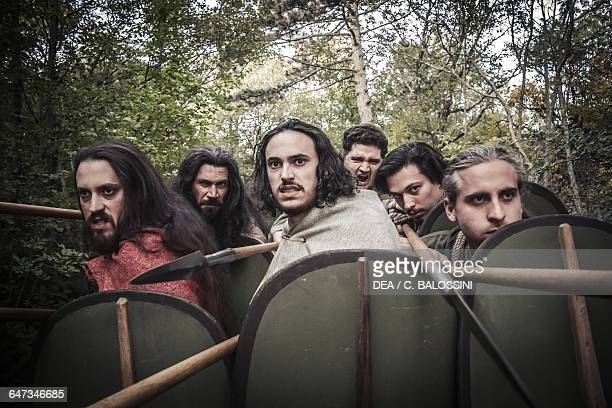 Warriors with spears and shields ready to attack the enemy Illyrian civilisation mid3rd century BC Historical reenactment