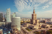 The skyline of central Warsaw at daytime. On the right stands the Palace of Culture and Science, an example of stalinist architecture from the 1950s.