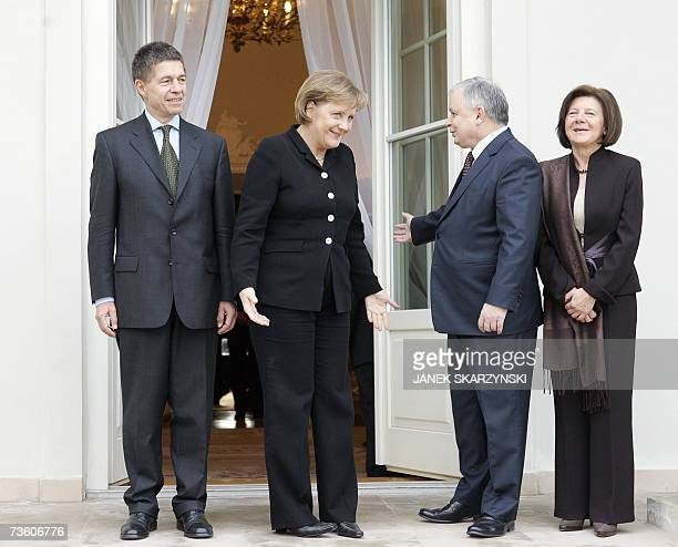 Polish President Lech Kaczynski and his wife Maria meet with German Chancellor Angela Merkel and her husband Joachim Sauer in the presidential palace...
