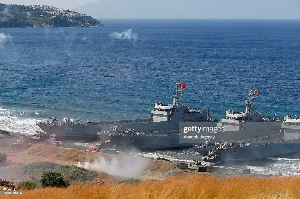 Warships are seen during the Efes-2016 Combined Joint Live Fire Exercise at Seferihisar district of Izmir, Turkey on May 31, 2016. The Turkish-led multinational military exercises, Efes-2016 which started at 04 May and will be finished at 04 June 2016, aims to train participating units and staff in planning and conducting combined and joint operations, including logistics and command-control as well as to improve the level of interoperability among headquarters and forces.