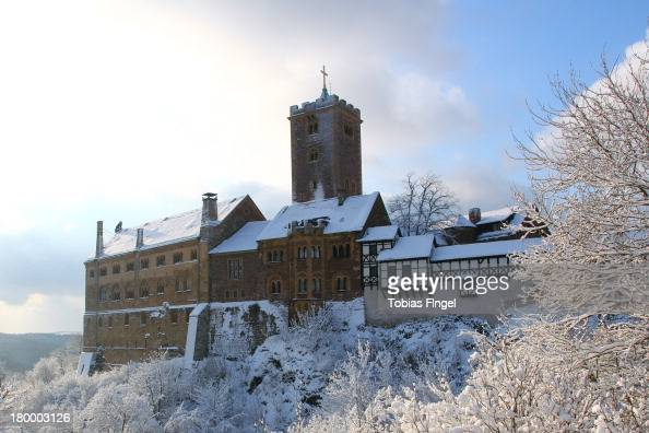 CONTENT] Wartburg Castle near the little town Eisenach caught in a bright Winter day with sun covered by snow It was in this castle that Luther went...