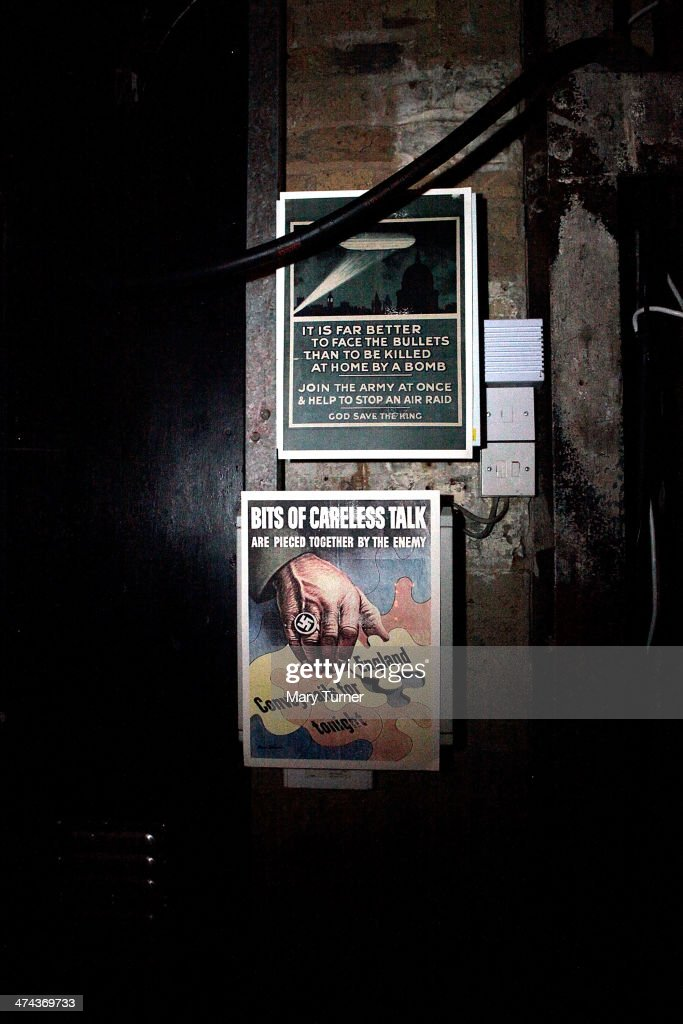 Wartime notices adorn the walls of a darkened Shoreditch warehouse, transforming it into The Blitz Party on February 22, 2014 in London, England. Deep in an East End bunker hundreds of vintage enthusiasts partied like it was 1940 in a range of 1940s costumes, dancing to Swing and Jazz music while drinking 1940s themed cocktails, as they embraced the glamour of and nostalgia for the era.