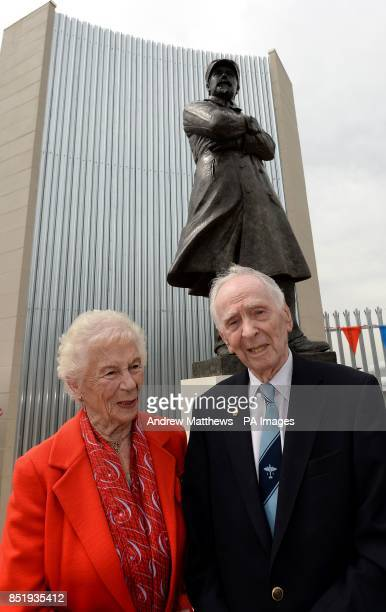 Wartime testpilot Captain Eric Winkle Brown and his wife Jean pose in front of the Samuel Cody statue which has been unveiled at the Farnborough Air...