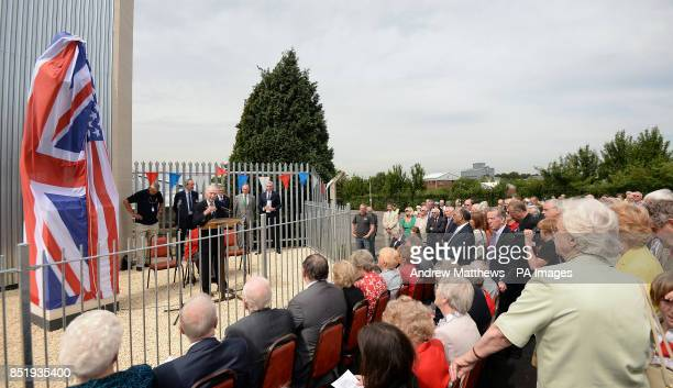 Wartime testpilot Captain Eric 'Winkle' Brown releases the cover on the Samuel Cody statue as it is unveiled at the Farnborough Air Sciences Trust to...