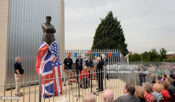 Wartime testpilot Captain Eric Winkle Brown releases the cover on the Samuel Cody statue as it is unveiled at the Farnborough Air Sciences Trust to...