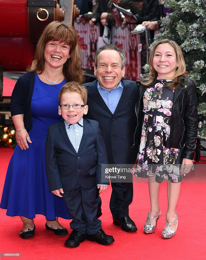 warwick davis and family attend the uk premiere of get