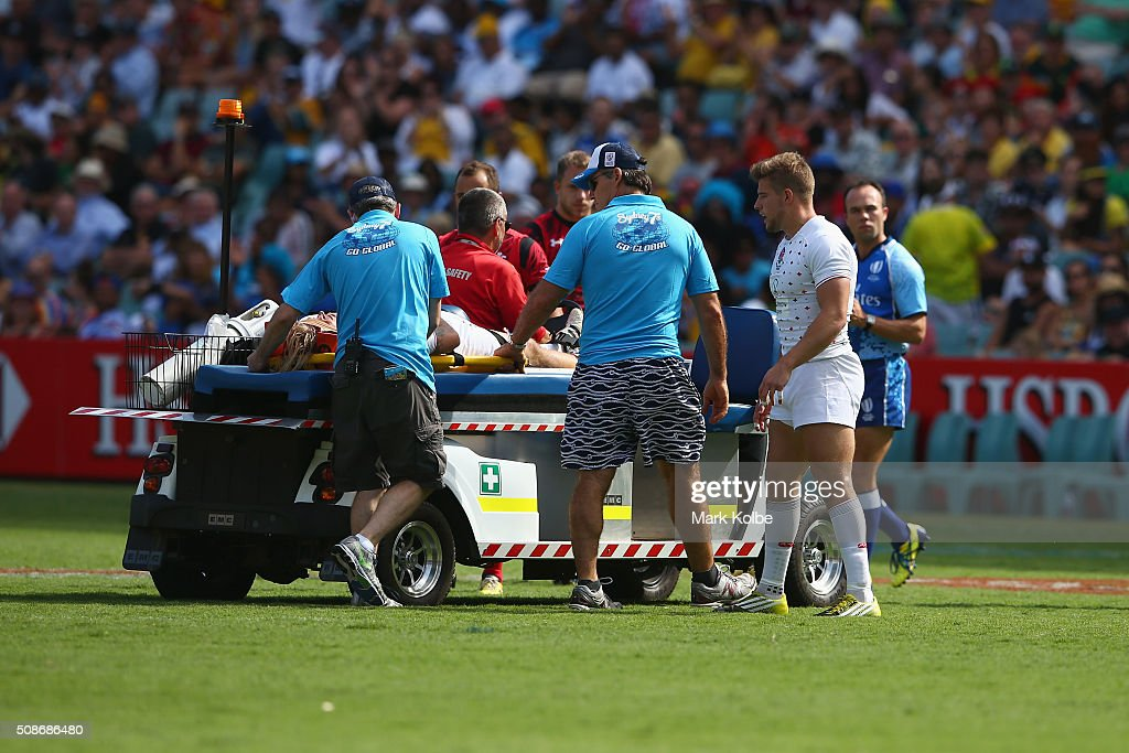 Warwick Lahmert of England leaves the field on a medicab during the match between England and Wales at the 2016 Sydney Sevens at Allianz Stadium on February 6, 2016 in Sydney, Australia.