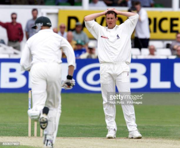 Warwickshire and England spin bowler Ashley Giles watches Worcestershire's Phillip Weston and Graeme Hick pile on the runs during a second wicket...