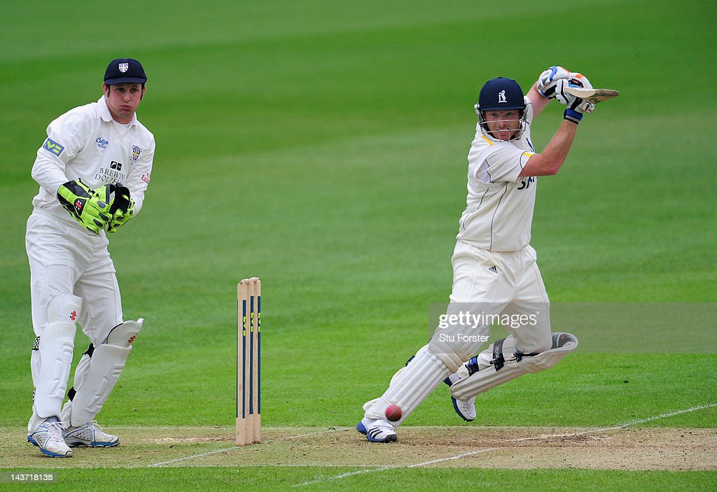 Warwickshire batsman Ian Bell cuts a ball to the boundary watched by Phil Mustard during day two of the LV County Championship division one match...