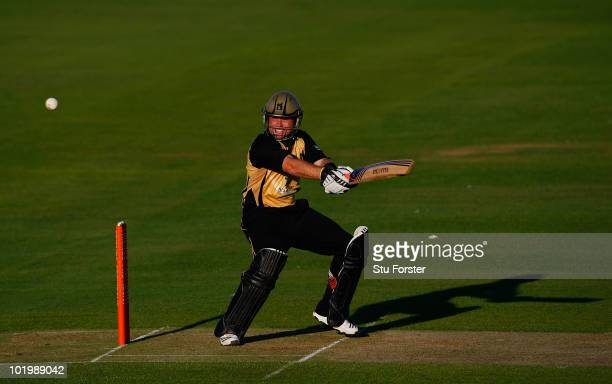 Warwickshire batsman Ian Bell hits a boundary during the Friends Provident T20 match between Warwickshire and Durham at Edgbaston on June 11 2010 in...