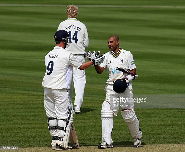 Warwickshire batsman Jeetan Patel is congratulated on his maiden first class century by Jonathan Trott as they compile a record double century...