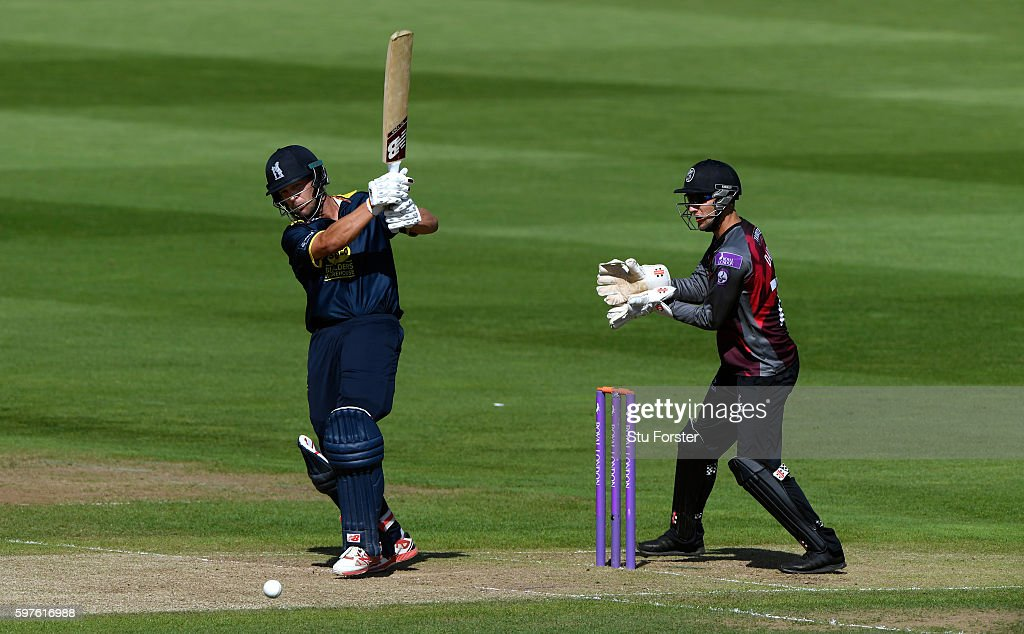 Warwickshire batsman Jonathan Trott hits out watched by wicketkeeper Ryan Davies during the Royal London One-Day Cup semi final between Warwickshire and Somerset at Edgbaston on August 29, 2016 in Birmingham, England.