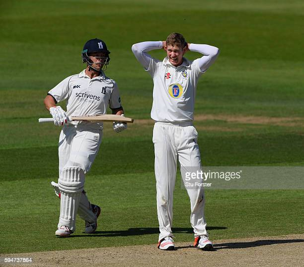 Warwickshire batsman Jonathan Trott picks up a run as bowler Keaton Jennings reacts during day two of the Specsavers County Championship Division One...