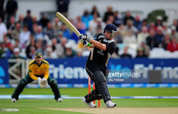 Warwickshire batsman Neil Carter hits a boundary during the Friends Life T20 match between Nottinghamshire and Warwickshire at Trent Bridge on June...