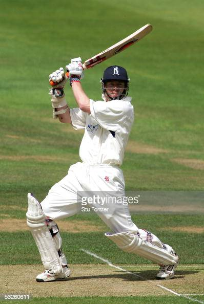Warwickshire batsman Nick Knight cuts a ball to the boundary during the first day of the Frizzell County Championship Division One game between...