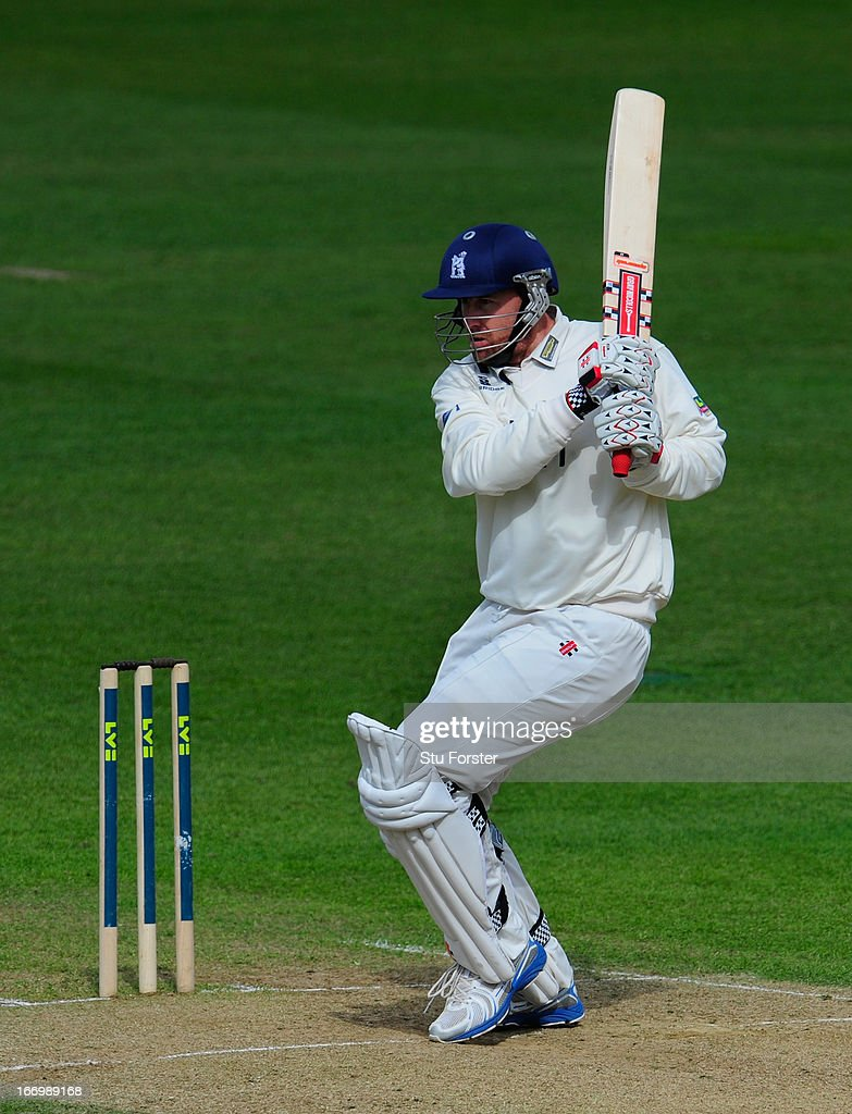 Warwickshire batsman <a gi-track='captionPersonalityLinkClicked' href=/galleries/search?phrase=Rikki+Clarke&family=editorial&specificpeople=636905 ng-click='$event.stopPropagation()'>Rikki Clarke</a> cuts a ball to the boundary watched by Durham keeper Phil Mustard during day three of the LV County Championship Division One game between Warwickshire and Durham at Edgbaston on April 19, 2013 in Birmingham, England.