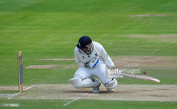 Warwickshire batsman Rikki Clarke reacts after being struck in the chest by a delivery from Gareth Andrew during day three of the Division One LV...