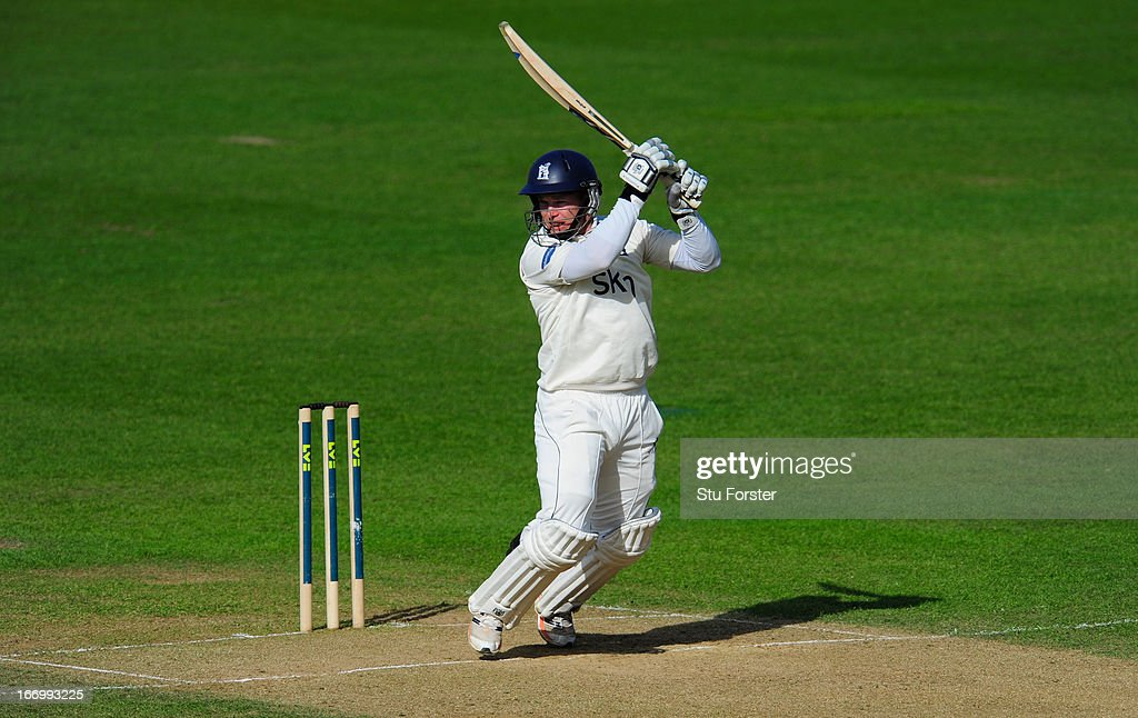 Warwickshire batsman <a gi-track='captionPersonalityLinkClicked' href=/galleries/search?phrase=Tim+Ambrose&family=editorial&specificpeople=757624 ng-click='$event.stopPropagation()'>Tim Ambrose</a> cuts a ball to the boundary during his century during day three of the LV County Championship Division One game between Warwickshire and Durham at Edgbaston on April 19, 2013 in Birmingham, England.