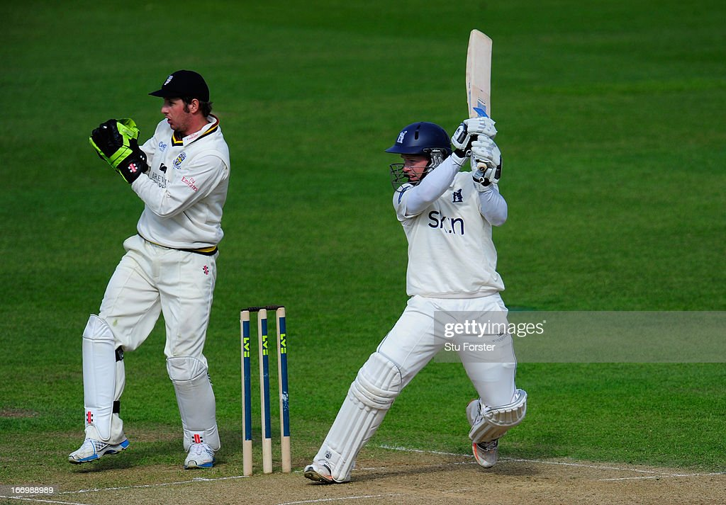 Warwickshire batsman <a gi-track='captionPersonalityLinkClicked' href=/galleries/search?phrase=Tim+Ambrose&family=editorial&specificpeople=757624 ng-click='$event.stopPropagation()'>Tim Ambrose</a> cuts a ball to the boundary watched by Durham keeper <a gi-track='captionPersonalityLinkClicked' href=/galleries/search?phrase=Phil+Mustard&family=editorial&specificpeople=824851 ng-click='$event.stopPropagation()'>Phil Mustard</a> during day three of the LV County Championship Division One game between Warwickshire and Durham at Edgbaston on April 19, 2013 in Birmingham, England.