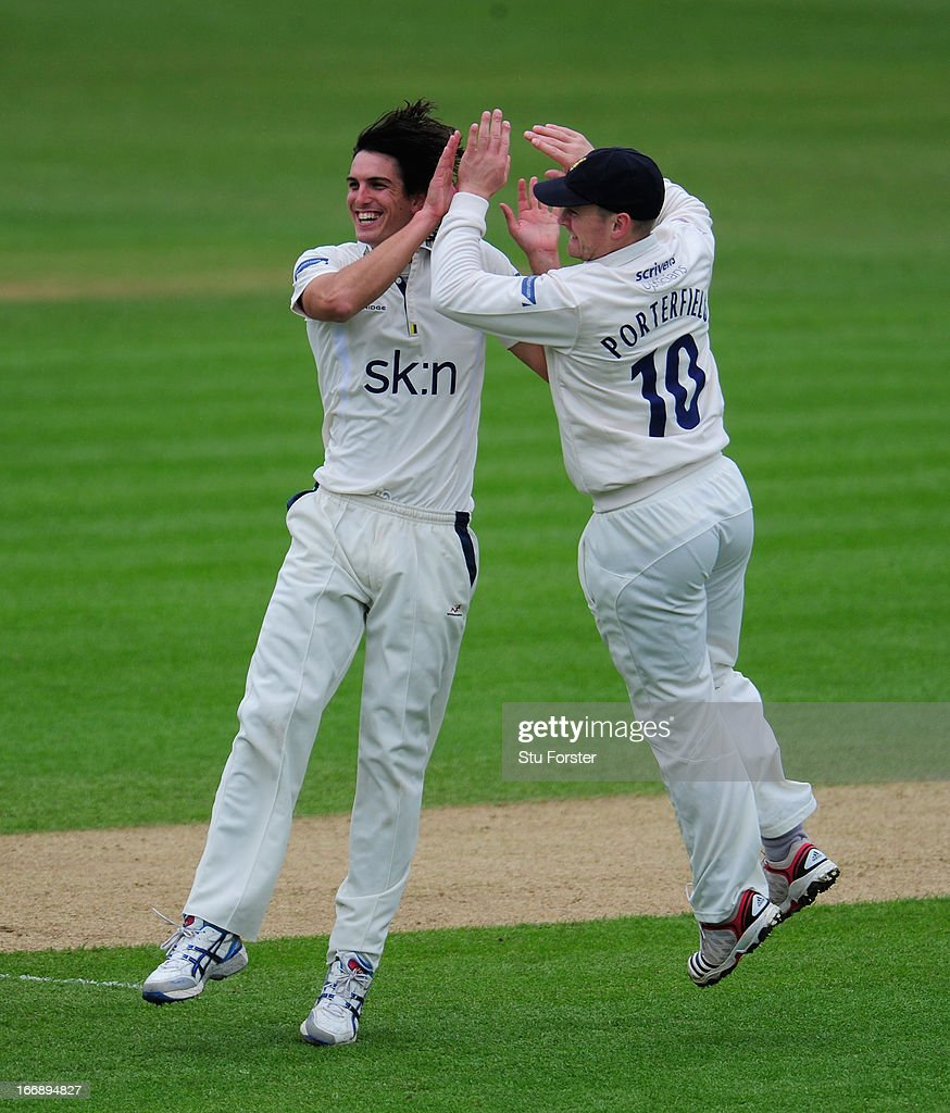 Warwickshire bowler <a gi-track='captionPersonalityLinkClicked' href=/galleries/search?phrase=Chris+Wright+-+Cricket+Player&family=editorial&specificpeople=14555411 ng-click='$event.stopPropagation()'>Chris Wright</a> (l) celebrates with William Porterfield after taking the wicket of Durham batsman Dale Benkenstein during day two of the LV County Championship Division One game between Warwickshire and Durham at Edgbaston on April 18, 2013 in Birmingham, England.