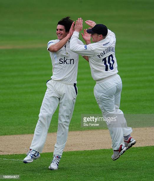 Warwickshire bowler Chris Wright celebrates with William Porterfield after taking the wicket of Durham batsman Dale Benkenstein during day two of the...