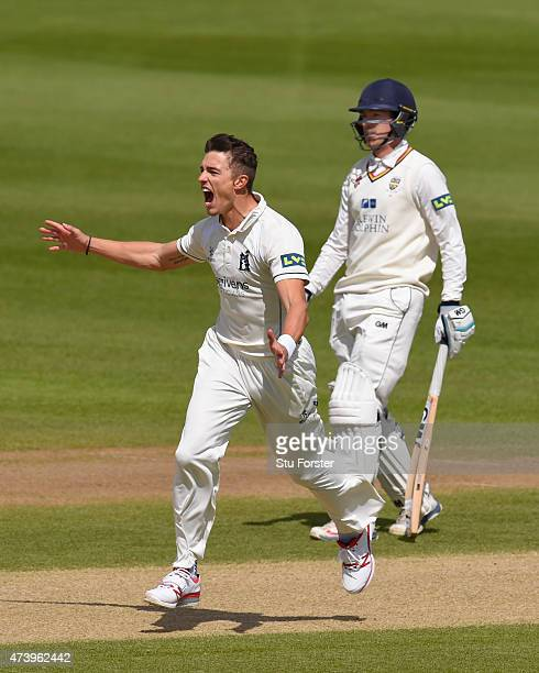 Warwickshire bowler Richard Jones celebrates after dismissing Durham batsman Calum MacLeod as Michael Richardson looks on during day three of the LV...