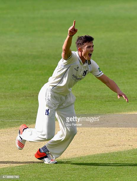 Warwickshire bowler Richard Jones celebrates after dismissing Scott Borthwick during day two of the LV County Championship Division One match between...