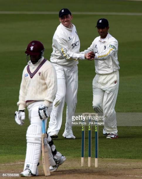 Warwickshire bowler Rikki Clarke celebrates with Varun Chopa after he took the catch of Somerset batsman Vernon Philander during the LV County...