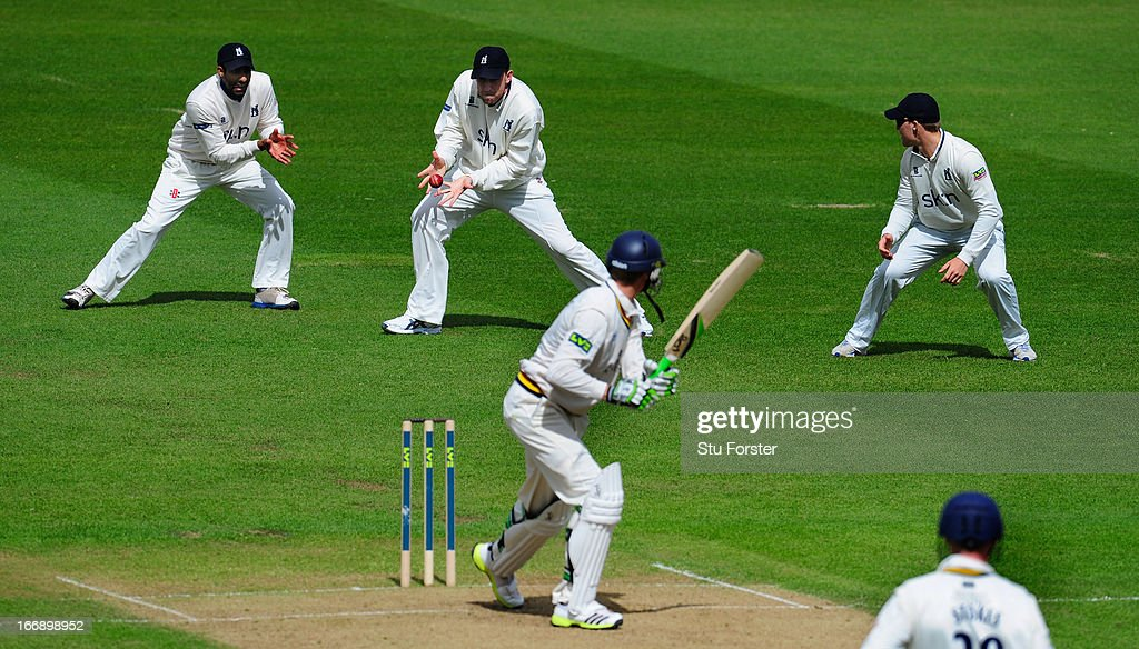 Warwickshire slip fielder <a gi-track='captionPersonalityLinkClicked' href=/galleries/search?phrase=Rikki+Clarke&family=editorial&specificpeople=636905 ng-click='$event.stopPropagation()'>Rikki Clarke</a> takes the catch to dismiss Durham batsman Keaton Jennings during day two of the LV County Championship Division One game between Warwickshire and Durham at Edgbaston on April 18, 2013 in Birmingham, England.