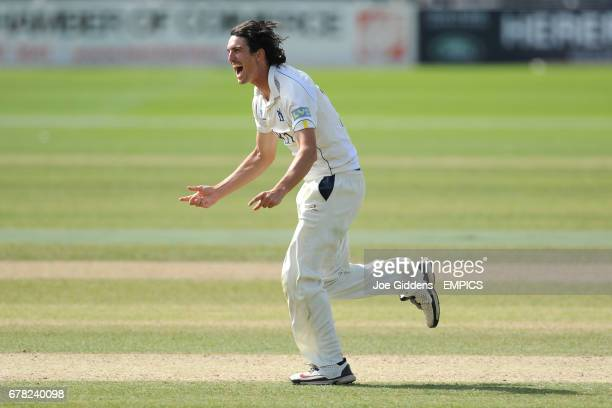 Warwickshire's Chris Wright celebrates taking the wicket of Worcestershire's Alan Richardson to win the LV County Championship Division One