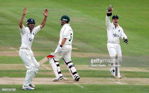 Warwickshire's keeper Tim Ambrose and Ant Botha appeal unsuccessfully for a stumping of Nottinghamshire's Steven Mullaney during the LV County...