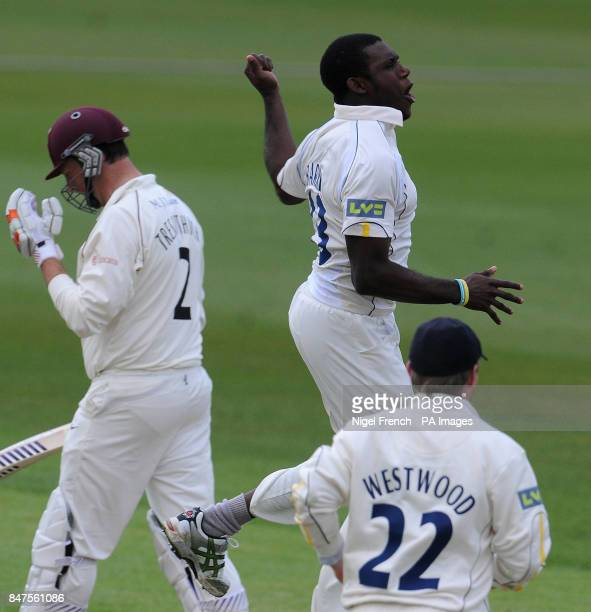 Warwickshire's Keith Barker celebrates after taking the wicket of Somerset's Marcus Trescothick during the LV County Championship Division One match...