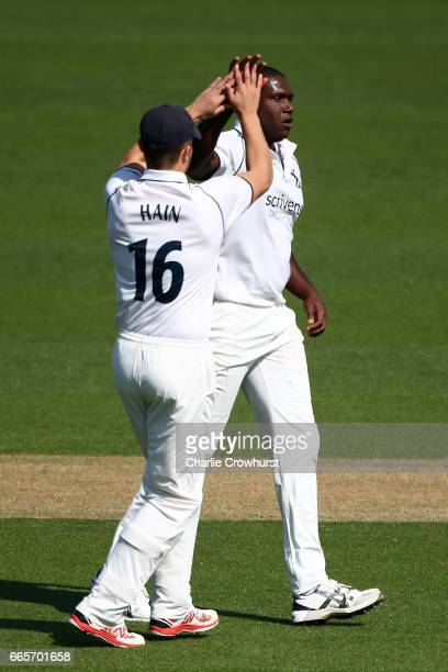 Warwickshire's Keith Barker celebrates with team mate Sam Hain after claiming the wicket of Surrey's Rory Burns during the Specsavers County...