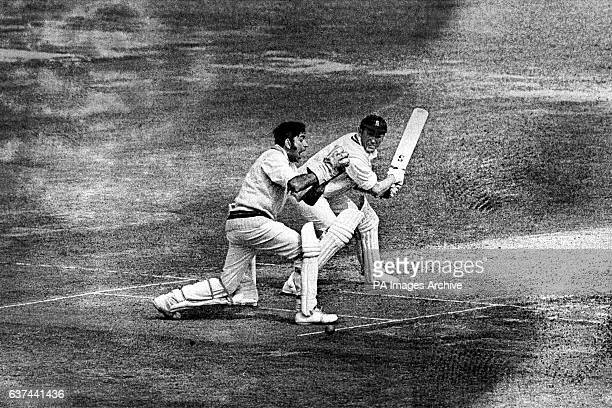 Warwickshire's Mike Smith has a narrow escape as Lancashire wicketkeeper Farokh Engineer fails to hold a catch