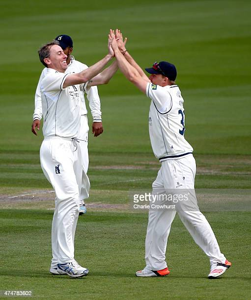 Warwickshire's Rikki Clarke celebrates with team mate Ian Westwood after taking the wicket of Sussex's Luke Wright during day three of the LV County...