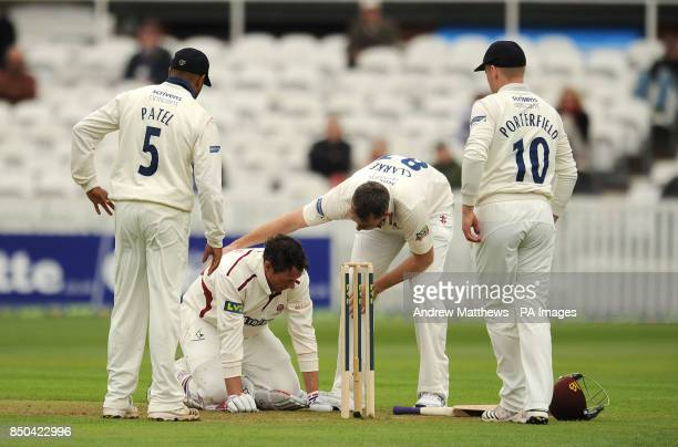 Warwickshire's Rikki Clarke checks on Somerset's Marcus Trescothick after he is hit by one of his bouncers during the LV= County Championship...