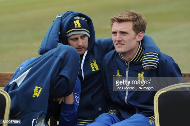 Warwickshire's Sam Hain Tom Allin and Oliver HannonDalby feel the cold during the photocall at Edgbaston Cricket Ground Birmingham