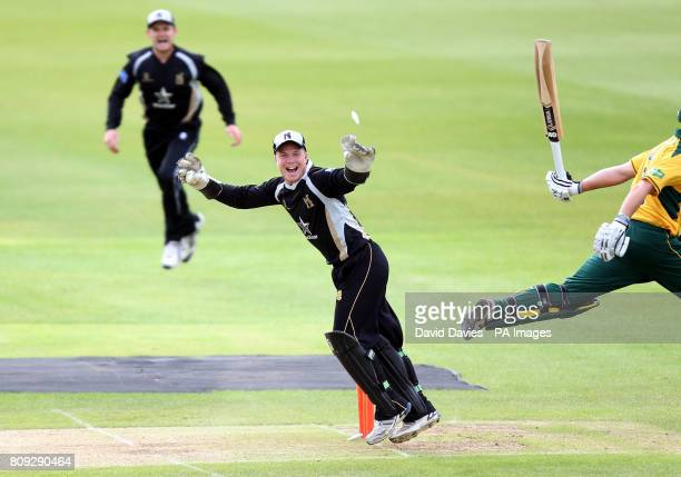 Warwickshire's Tim Ambrose celebrates Nottinghamshire's Riki Wessels being run out for 70 during the t20 Group match at Edgbaston Birmingham