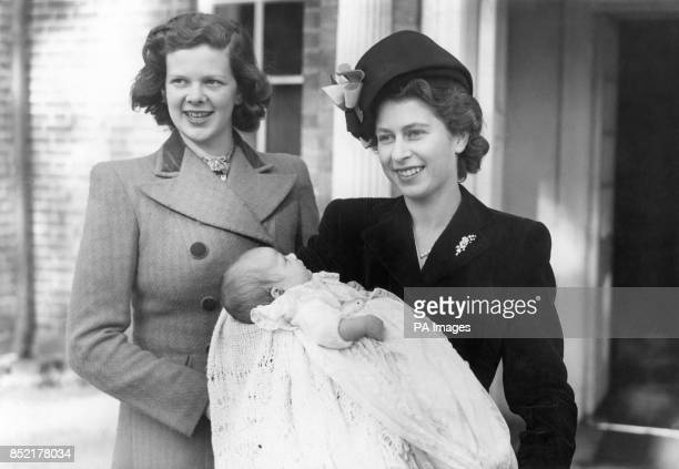 ELIZABETH was present at the Parish Church Worplesdon Surrey to stand as godmother to the infant daughter of her ladyinwaiting the Hon Mrs ANDREW...