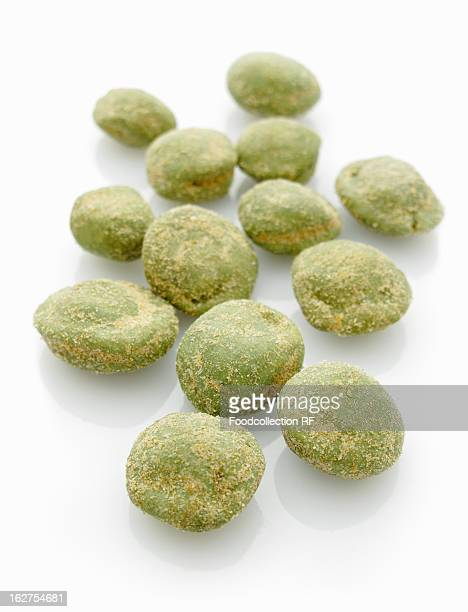 Wasabi peanuts against white background