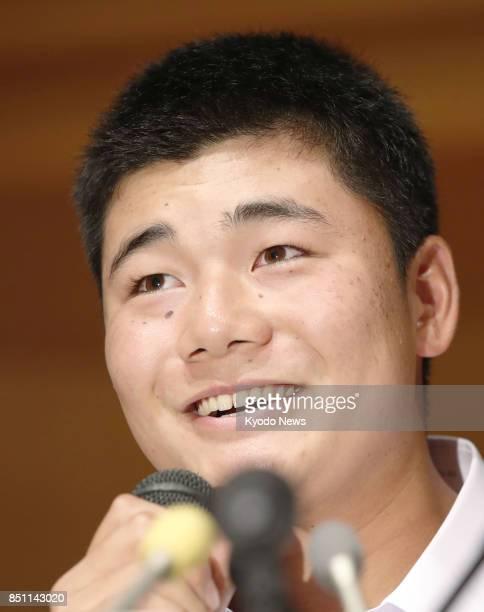Waseda Jitsugyo high school slugger Kotaro Kiyomiya attends a press conference in Tokyo on Sept 22 2017 Kiyomiya said he will pursue a professional...