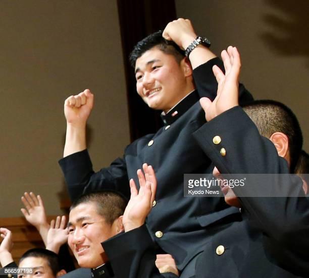 Waseda Jitsugyo High School slugger Kotaro Kiyomiya is congratulated by his schoolmates in Kokubunji Tokyo on Oct 26 2017 after being selected by the...