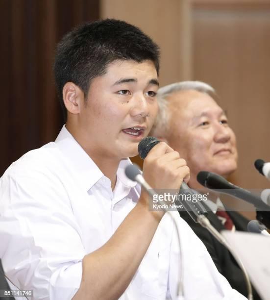 Waseda Jitsugyo high school slugger Kotaro Kiyomiya speaks at a press conference in Tokyo on Sept 22 alongside manager Minoru Izumi Kiyomiya said he...